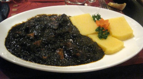 Cuttlefish in ink sauce with polenta, at Vino Vino in Venice