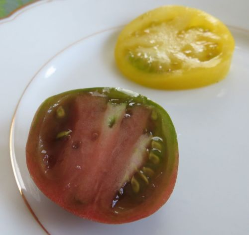 A Carbon tomato and a slice of the beautiful yellow Golden Queen